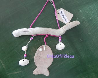 Mobile with driftwood, fish, pearls and shells