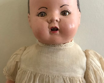 Antique composition baby doll with cute little teeth