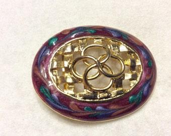 Vintage 1980's epoxy enamel swirls on gold filigree brooch pin.