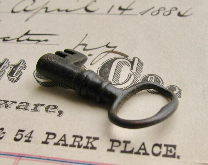 Bent black steamer trunk key, refinished - 1 inch long - dark, distressed, antiqued black patina, authentic vintage key, rustic old key