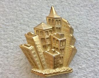 Park Lane designer skyline cityscape gold toned metal brooch pin.