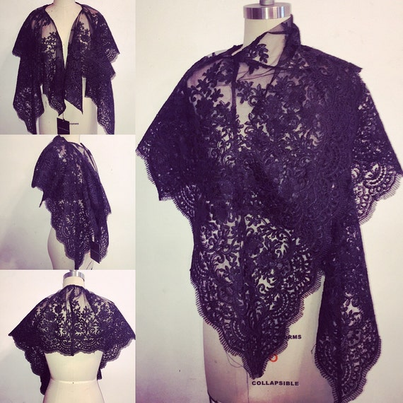 Irina Shabayeva black lace capelet wrap with scalloped edges .