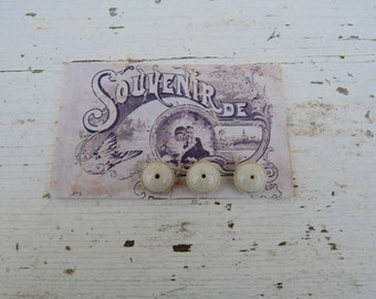 Vintage Antique /1900s French  off white ceramic buttons set of 3  on a card