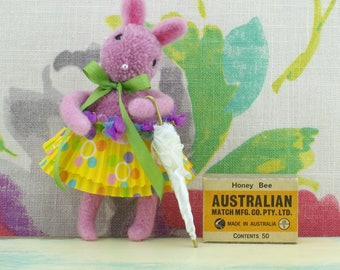 Handmade pom pom pink bunny rabbit holding umbrella. Hanging ornament.
