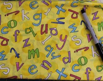 Tossed Alphabet on yellow fabric  100% cotton fabric