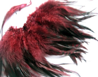 """2"""" strip of Strung Rooster Saddles Chinchilla feathers in burgundy with black - invividual feathers about 5.5=6"""" long"""