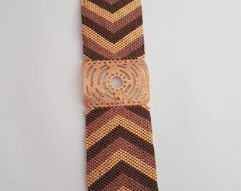 Filigree cuff weaving peyote and plate