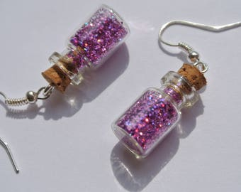 a pair of earrings purple bottle