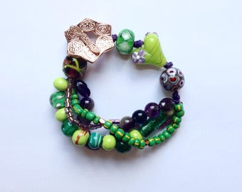 Four Strand Green and Purple Beaded Bracelet 7 Inches