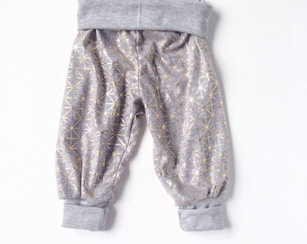 Cute gold geometric Harem pants for baby or toddler.