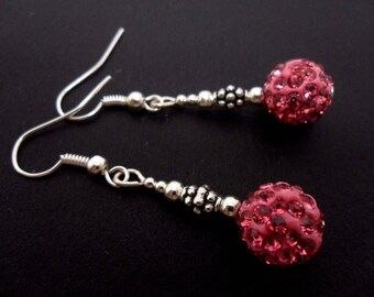A pair of pretty pink shamballa style dangly earrings.