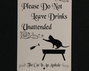 Please Do Not Leave Drinks Unattended, The Cat is an Asshole 12 inch wide by 18 inch tall Metal Sign Indoor/Outdoor Sign