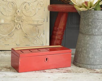 vintage red metal cash tin with different slots for different sections