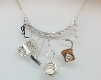 Sterling silver life choker with glasses, book, biro, key & egg on toast