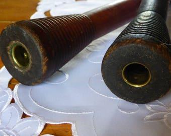 Two tall wood spools