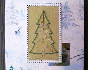 Picture embroidered on a background of forest green Christmas tree