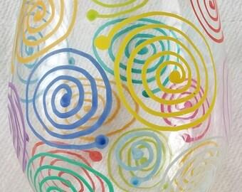 Multi-colored swirl painted wine glass