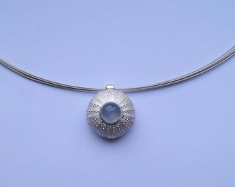 Silver sea urchin pendant as a necklace with Chalcedon