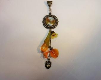 Butterfly under glass pendant