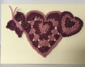 Birthday card with crochet hearts and a crochet butterfly