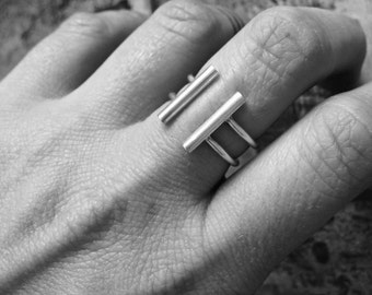 Ring double ring, adjustable, ending with two thick bars of sterling silver