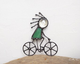 Bicyclist girl. Stained glass brooch