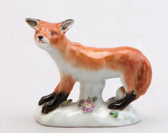 A Meissen Porcelain Figure Of A Fox, 1955 Blue Crossed Swords Mark, Impressed Model No. 147 And Date Mark.  5.5 Cm High