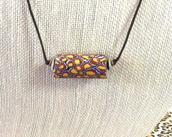 African Trade Bead Brown and Yellow on Two Knot Cord