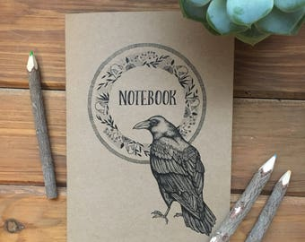 A5 recycled kraft notebook with unique raven illustration