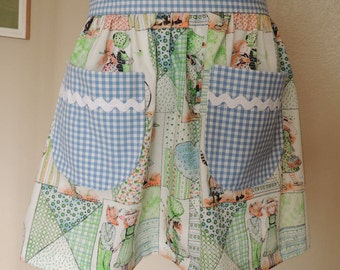 Holly Hobby Child's Apron with blue gingham pockets and waistband