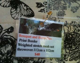 Bouquet and Butterflies calico print weighted mesh net throwover.