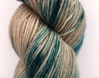 A beautifully soft hand dyed 4ply yarn in shades of sea green and light brown on a merino, cashmere, nylon base.