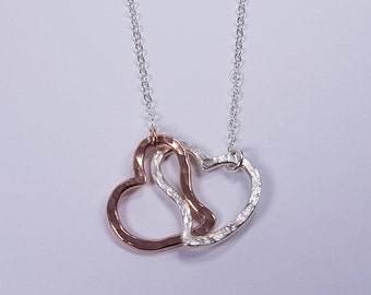 An lovely Pair of unit heart handmade in Rose gold-fill and Sterling silver pendant. 25% Off. Free shipping