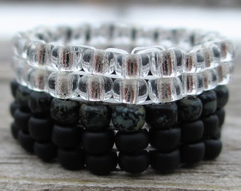 Silver and black beaded ring