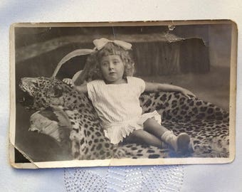 Old photograph, photograph of pre-revolutionary period, Portrait of little girl, story of girl in photos, vintage style, retro style photo