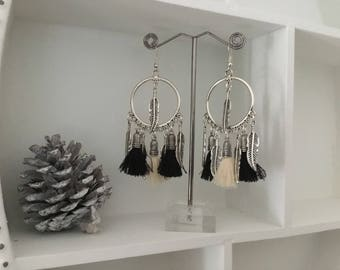 Fancy feather charm earrings and black and beige tassels