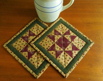 Quilted Pot Holders /Set of two pot holders, Ohio Star pattern with fabrics in blue, burgundy and beige