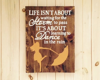 Learning to Dance in the Rain, Wooden Sign