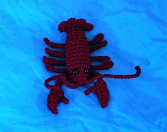 Crochet burgundy lobster toy