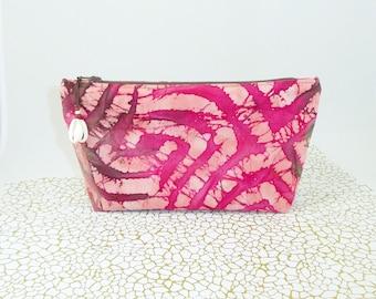Makeup bag in Fuchsia, brown tones, batik fabric.
