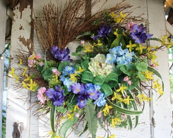 Spring twiggy wreath, spring silk flower wreath, colorful wreath with blue hydrangeas, purple iris, yellow forsythia, pink geraniums