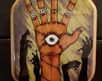 Severed Fingers Illustration on Wood Plaque