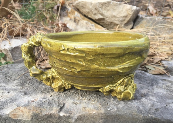 medium sized handled soup bowl in olive green