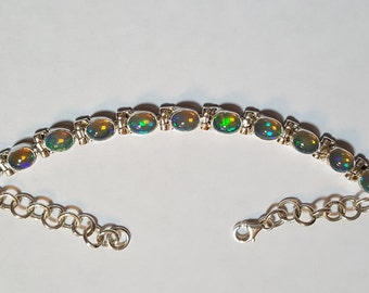 6.75ctw 7x5 mm Ethiopian Opal Sterling Silver Adjustable Bracelet 6.50-8 inch