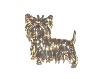 brooch, pin, 9ct gold coated , dog design. with black enamel features.