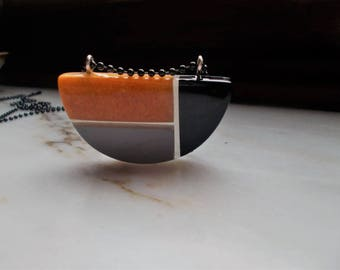 Modern pendant made of polyester resin gold black and gray