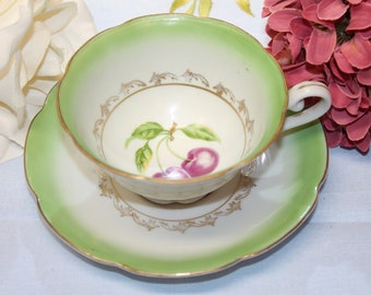 CASTLE China Teacup and Saucer Set.