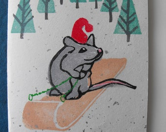 Original linocut block print, Christmas card on vintage silver sparkle Japanese paper, hand carved rubber stamps, Mouse Tobogganing