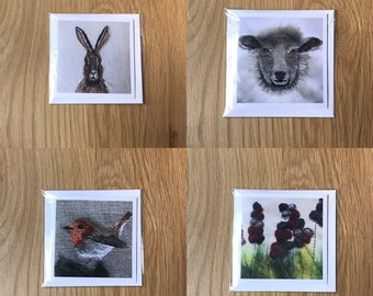 Pack of 4 greeting cards: hare, sheep, flowers and robin