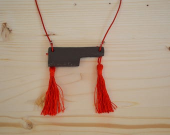 Black ceramic geometric necklace with red tassels